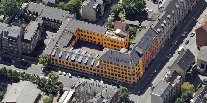 Aerial over the purchased building.